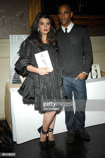 Models Crystal Renn and Brent Zachery attend a celebration for Crystal Renn's new book titled Hungry at the Soho Grand Hotel on September 8 2009 in...