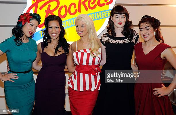 Models Crystal Taylor Alex Garcia Holly Madison Molly Kaiser and Carla Avila appear in Bettie Page style dress at Johnny Rockets at the Flamingo Las...