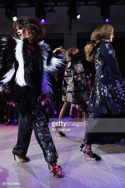 Models dance down the runway at the Libertine fashion show during New York Fashion Week The Shows at Gallery II at Spring Studios on February 12 2018...