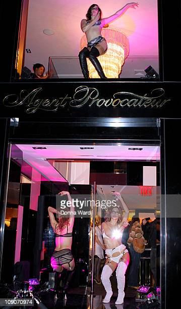Models dance in the windows at the Agent Provocateur flagship store launch party on February 13 2011 in New York City