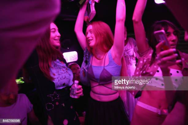 Models dance on the party bus before the Maryam Nassir Zadeh fashion show during New York Fashion Week on September 12 2017 in New York City