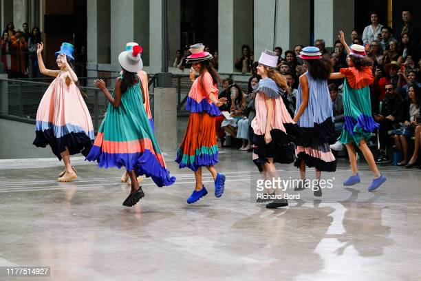 Models dance on the runway during the Issey Miyake Womenswear Spring/Summer 2020 show at Le 104 as part of Paris Fashion Week on September 27, 2019...