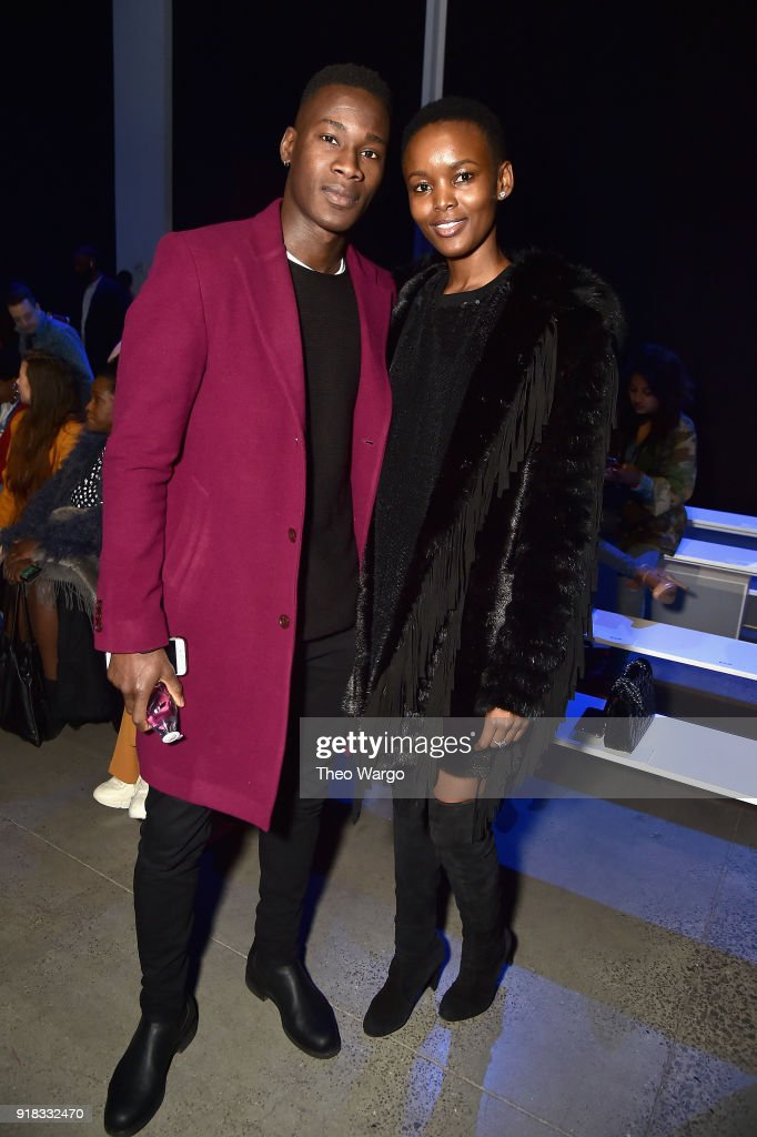 Models David Agbodji (L) and Flaviana Matata attend the Laquan Smith front row during New York Fashion Week: The Shows at Gallery I at Spring Studios on February 14, 2018 in New York City.