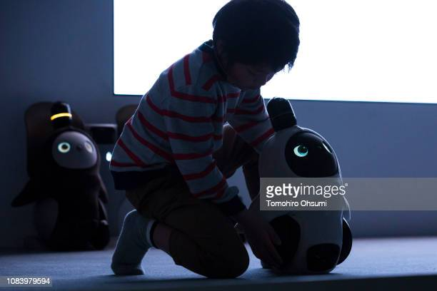 Models demonstrate interacting with Lovot robots developed by Groove X Inc during an unveiling event on December 18 2018 in Tokyo Japan Groove X a...