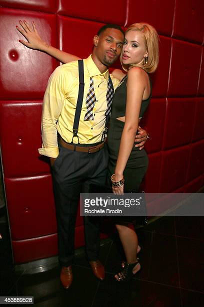Models Denzel Wells and Mirjana Puhar attend America's Next Top Model Cycle 21 premiere party presented by NYLON and LINE at SupperClub Los Angeles...