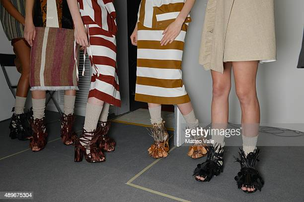 Models detail are seen backstage ahead of the N21 show during Milan Fashion Week Spring/Summer 2016 on September 23 2015 in Milan Italy