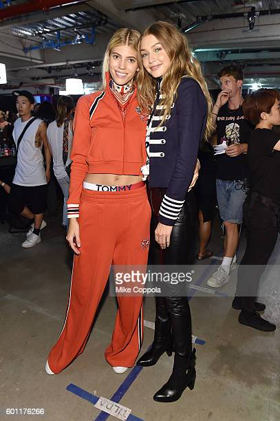 Models Devon Windsor and Gigi Hadid pose backstage at the #TOMMYNOW Women's Fashion Show during New York Fashion Week at Pier 16 on September 9 2016...