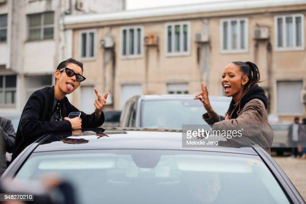 Models Dilone and Adesuwa Aighewi exit the Roberto Cavalli show and throw middle fingers and peace signs out of their car during Milan Fashion Week...