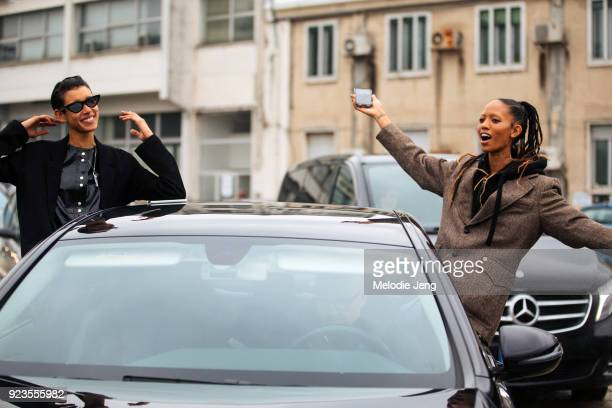 Models Dilone and Adesuwa Aighewi have fun and hang out the windows of their car during Milan Fashion Week Fall/Winter 2018/19 on February 23 2018 in...
