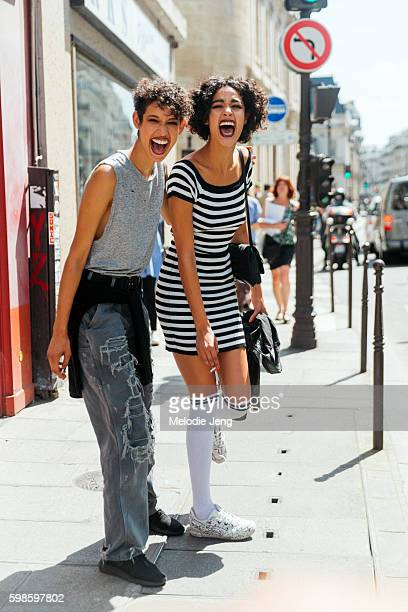 Models Dilone and Damaris Goddrie after the Jean Paul Gaultier couture show on July 06 2016 in Paris France Dilone wears a gray sleeveless cotton top...