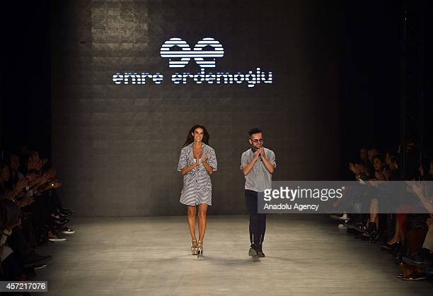 Models display a creation by designer Emre Erdemoglu at the MercedesBenz Fashion Week Istanbul at Antrepo 3 in Istanbul Turkey on October 14 2014