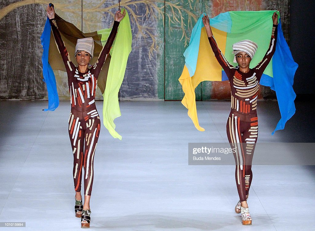 Models display a design by Walter Rodrigues during the first day of Fashion Rio Summer 2011 at Pier Maua on May 27, 2010 in Rio de Janeiro, Brazil.