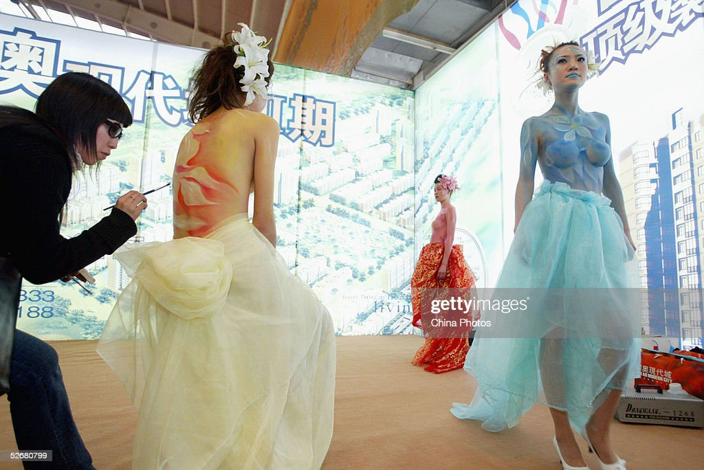 Models display body painting during a promotion activity at a real estate fair on April 21, 2005 in Shenyang of Liaoning Province, China. Body painting has stirred debate in China in recent years. In November 2003, the Ministry of Culture, the Ministry of Public Security and the State Administration of Industry and Commerce had issued a joint notice to ban public body-painting displays. It was reported that they were considered to have a negative impact on social morality.
