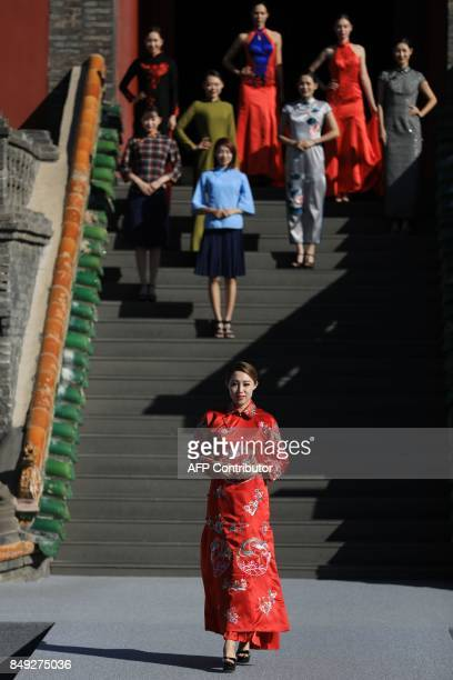 Models display cheongsams also known as qipaos during the First Shenyang International Cheongsam Cultural Festival at Shenyang Imperial Palaces in...