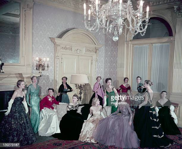 Models display Coronation evening gowns in Claridges Hotel in London circa 1953
