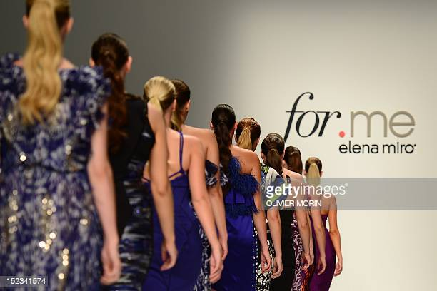 Models display creations as part of Elena Miro SpringSummer 2013 fashion show on September 19 2012 during the Women's fashion week in Milan AFP PHOTO...