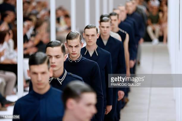 Models display creations by Belgian designer Kris Van Assche for the label Dior during the men's springsummer 2013 fashion collection show on June 30...