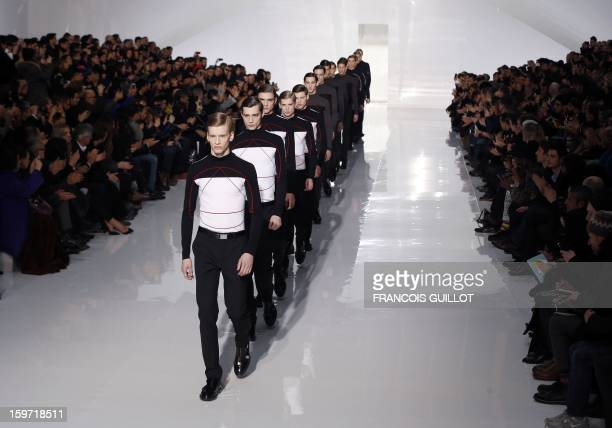 Models display creations by Belgian designer Kris Van Assche for the label Dior during the men's Fall-Winter 2013-2014 collection show on January 19,...