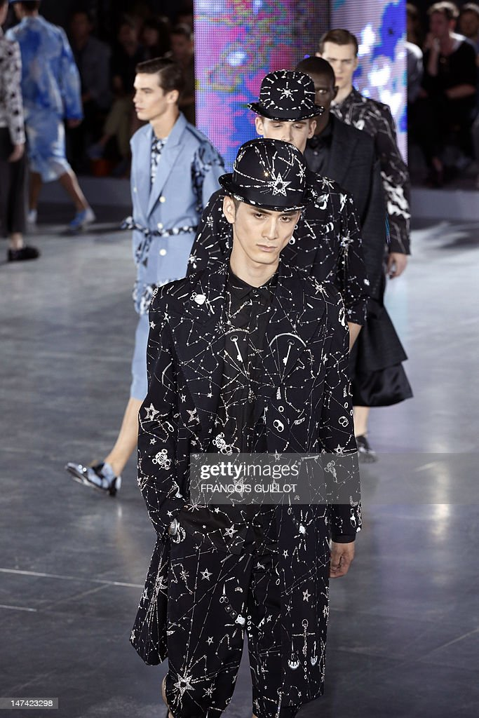 Models display creations by British fashion designer Bill Gaytten for the label John Galliano fashion house during the men's spring-summer 2013 fashion collection show on June 29, 2012 in Paris.