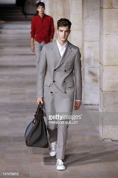 Models display creations by French designer Veronique Nichanian for the label Hermes during the men's springsummer 2013 fashion collection show on...