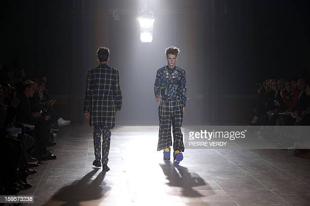 Models display creations by Japanese designer Arashi Yanagawa for the label John Lawrence Sullivan during the men's FallWinter 20132014 collection...