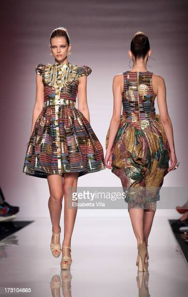 Models display creations by Kiki Clothing during It's Ethical Fashion 'Bring Africa to Rome' catwalk collection S/S 2014 fashion show as part of...