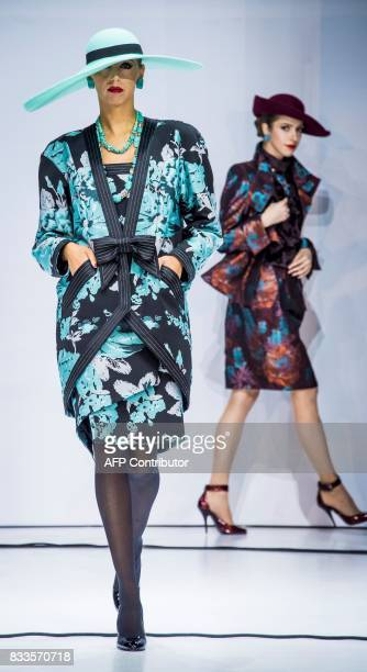 Models display creations by legendary Soviet-Russian designer Slava Zaitsev during a fashion show in Moscow on August 17, 2017. / AFP PHOTO / Mladen...