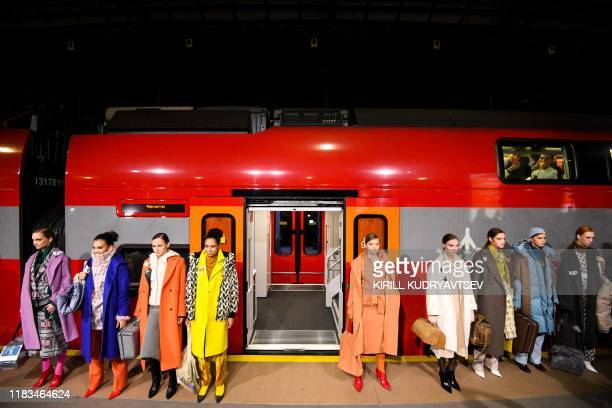 Models display creations by Russian fashion designer Victoria Andreyanova as part of Modest Fashion Week in Moscow on November 19, 2019. - There is...
