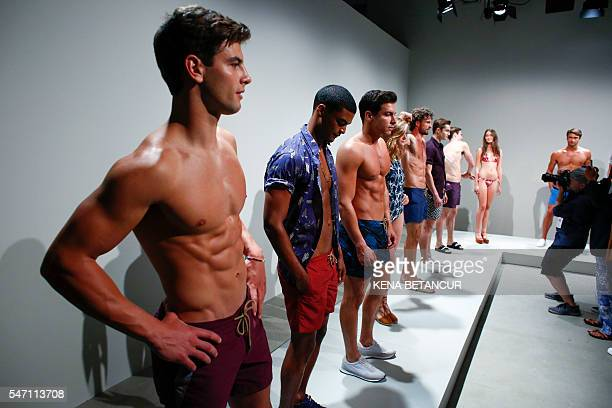Models display creations by Thorsun during the New York Fashion Week Men's Spring/Fall in New York on July 13 2016 / AFP / KENA BETANCUR