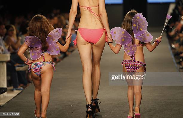 Models display creations during a swimwear fashion show on May 28 2014 in the Lebanese capital Beirut AFP PHOTO / STR