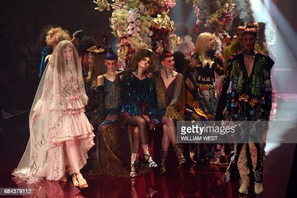 TOPSHOT Models display creations from the Australian label Romance Was Born during Fashion Week Australia in Sydney on May 18 2017 / AFP PHOTO /...