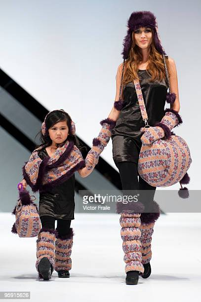 Models display creations of Tif Tiffy's Love Rain collection on the catwalk during the Brand Collection Show II show as part of the Hong Kong Fashion...