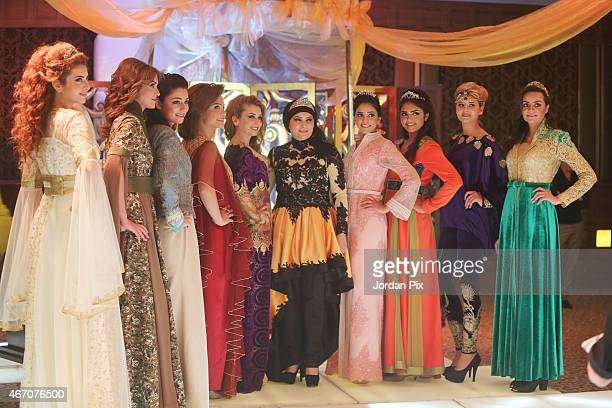Models display dresses by Jordanian designer Ayat Al Zoubi in her annual Abaya fashion show March 20 2015 in Amman Jordan
