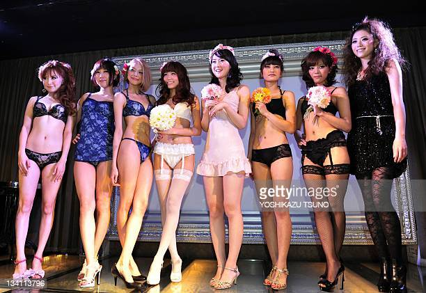 Models display lingerie from Japanese brand 'Mysterious Marguerite' produced by Japanese model and lingerie fitter Marina Wachi during her debut...