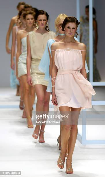 Models display minimal cocktail dresses during a preview of the 2003 spring and summer Miss Ashida collection in Tokyo, 01 November 2002. AFP...