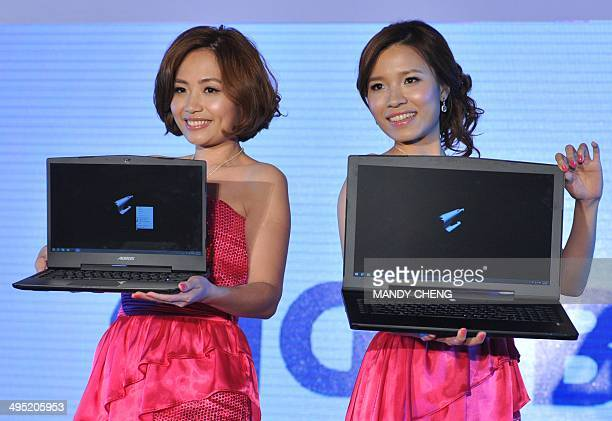 Models display new products during a preshow press conference ahead of the Computex trade fair in Taipei on June 2 2014 Asia's largest tech trade...