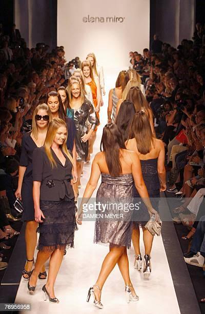 Models display outfits by designer Elena Miro during Spring/Summer 2008 collection show at Milan fashion week 22 September 2007 AFP PHOTO DAMIEN MEYER