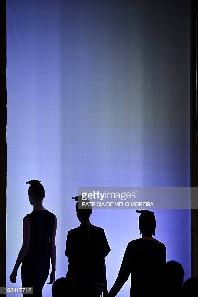 Models display outfits by Portuguese designer Alexandra Moura of the Autumn/Winter 20132014 collection during the 40th edition of the Moda Lisboa...