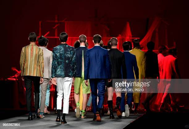 Models display outfits of Spanish designer Garcia Madrid Spring/Summer 2019 collection during the Madrid's Mercedes Benz Fashion Week on July 10 2018