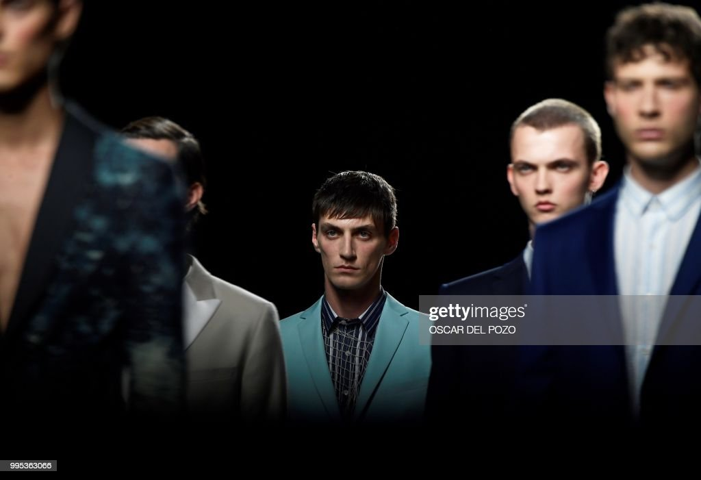Models display outfits of Spanish designer Garcia Madrid Spring/Summer 2019 collection during the Madrid's Mercedes Benz Fashion Week on July 10, 2018.