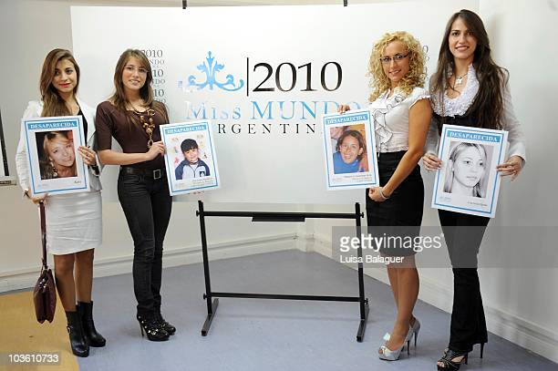 Models display photos of women kidnapped by trafficking networks in the Argentine province of Tucuman during the contest Miss World Argentina 2010 on...