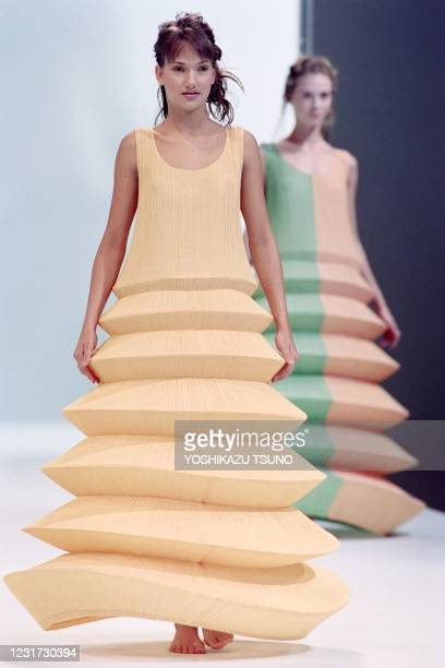 Models display Pleats please dresses with wired hoops as part of Issey Miyake Spring-Summer 1995 ready-to-wear collection in Paris on November 4,...