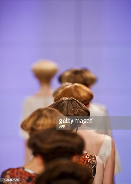 Models display Spring/Summer 2011 creations by Portuguese designer Alexandra Moura during the 35th Edition of Moda Lisboa at Mercado da Ribeira in...