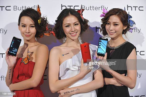 Models display Taiwan's electronics giant HTC's new smartphone 'HTCJ butterfly' during a press conference in Taipei on December 11 2012 The new...