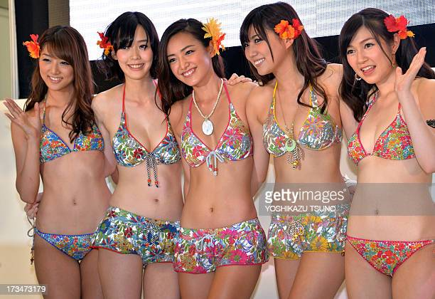 Models display the latest swimsuit collection from Japanese apparel maker Sanai in Tokyo on July 15 2013 AFP PHOTO / Yoshikazu TSUNO