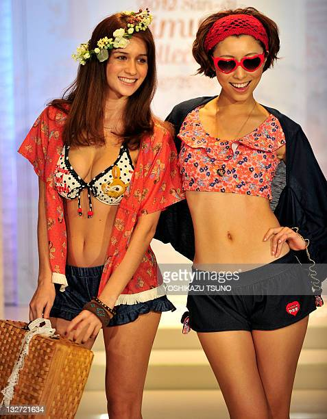 Models display the latest swimwear during Japanese apparel maker San-ai's 2012 collection in Tokyo on November 14, 2011. Japanese apparel maker...