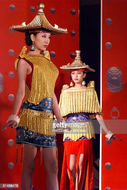 Models display the moderndesigns of oldBeijing's Forbidden City 02 November 2000 in Hong Kong during the Moving Forbidden City fashion show The...