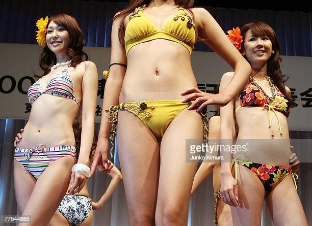 Models display the textile company Toray's 2008 swimwear range during the press preview at Oribe Hall on October 29 in Tokyo Japan