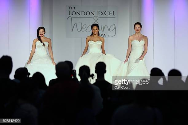 Models display wedding dress designs at the London Wedding Show at ExCel on January 30 2016 in London England The show advertises numerous businesses...