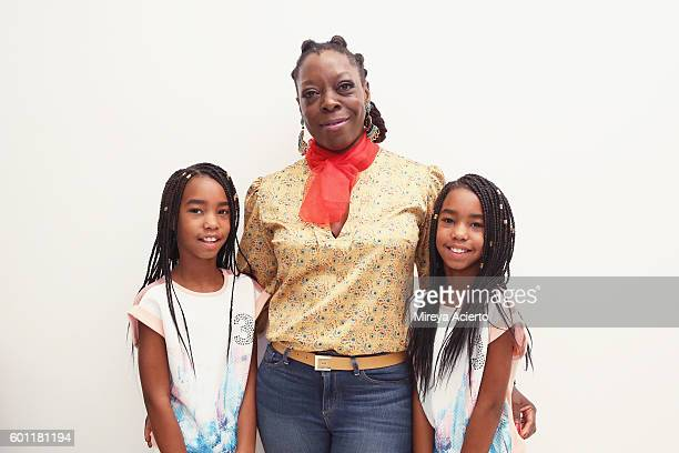 Models D'lila Combs and Jessie Combs pose with designer Amanda Rabor at Isossy London presentation during New York Fashion Week September 2016 at Go...
